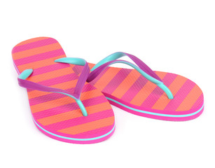 Pair of striped flip-flop sandals isolated on white