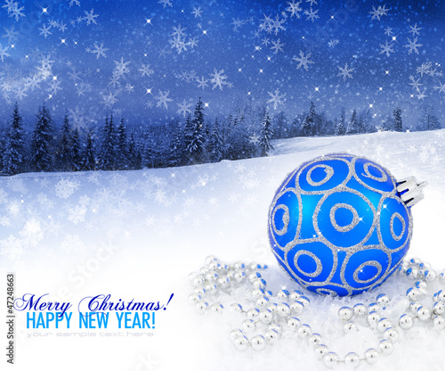 Blue christmas decoration on a background a winter landscape