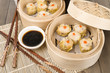 Siu Mai - Chinese pork and shrimp dumplings in bamboo steamers