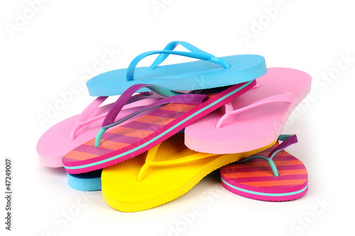 Pile of Colorful Flip Flops Isolated on White