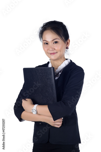 Portrait of a successful business woman holding a folder, lookin