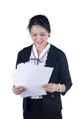 Smile with happiness business woman reading reports.