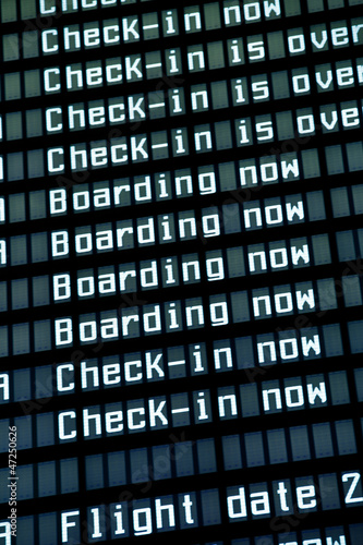 Flight arrival board in airport, closeup.