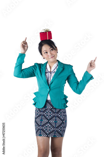Portrait of beautiful Asian woman with a gift box on her head
