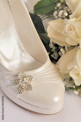 Bridal flowers and bridal shoe - wedding bouquet and shoe