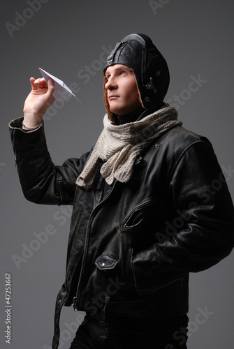Brutal man wearing pilot style clothes