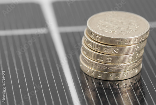 Macro PV Solar Panel and money.