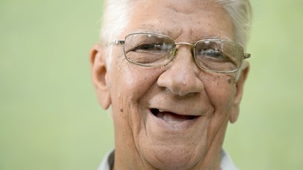 Happy old people, elderly man with eyeglasses smiling at camera