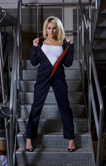 A very sexy blonde woman dressed in overalls.