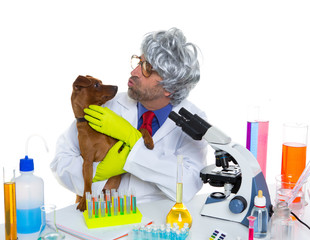 Crazy nerd scientist silly veterinary man with dog at lab