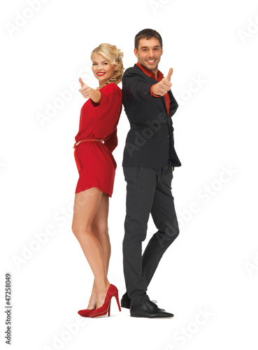 handsome man and lovely woman showing thumbs up