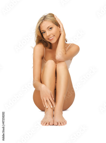 woman in cotton undrewear touching her legs