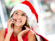 Female Santa on the phone