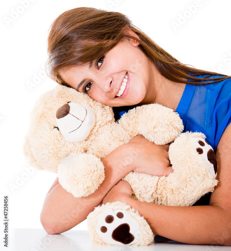 Sweet woman with a teddy bear
