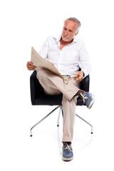 Casual senior man with newspaper, amused