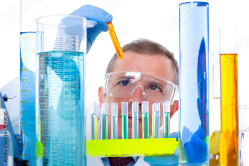 laboratory scientist working at lab with test tubes