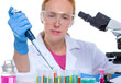 chemical laboratory scientist woman working with pipette