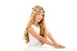 children blond girl with spring daisy flowers crown