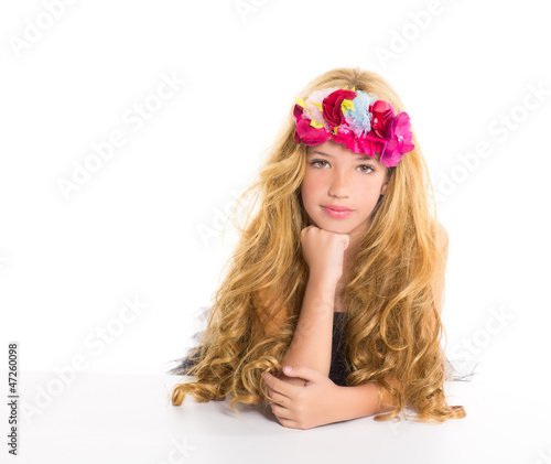 children fashion blond girl with spring flowers on head