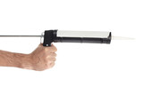 Applying silicone with caulking gun isolated on white