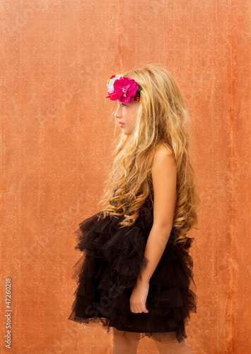 black dress kid girl profile on vintage background