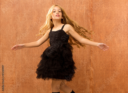 black dress kid girl dancing and twisting vintage