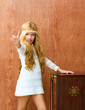 Blond children girl retro 70s with vintage furniture