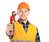 Young constructor in hard helmet with pliers