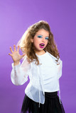 Children fashion scaring makeup kid girl on purple