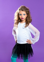 Children fashion makeup kid girl on purple