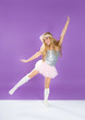 Children fashiondoll spring girl dancing on purple