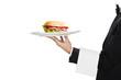 young waiter in work uniformon with sandwich