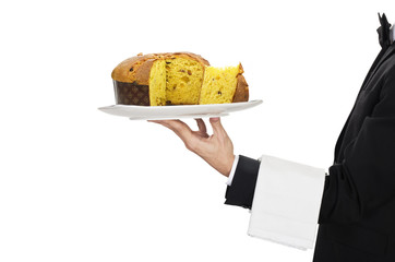 young waiter in work uniformon with panettone