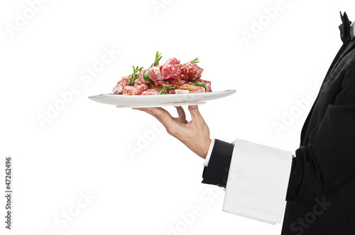 young waiter in work uniformon with sausage