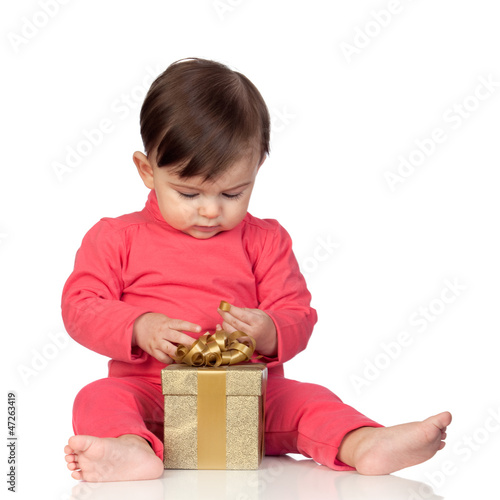 Adorable baby playing with a present