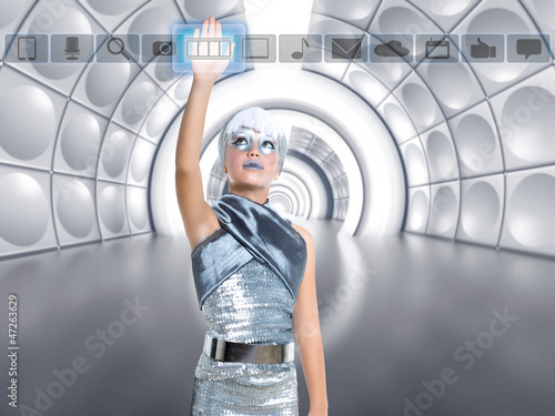 futuristic kid girl in silver touching finger icons