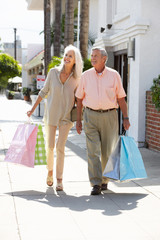 Senior Couple Carrying Shopping Bags