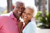Fototapety Romantic Senior Couple Hugging In  Street