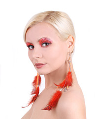 girl with feathers earrings isolated, fashion makeup