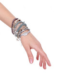 collection of bracelets on woman hand isolated