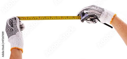 measure tape in hands with work gloves isolated on white