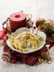 ravioli with cream and walnut on christmas table