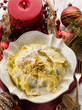 ravioli with cream and walnut on christmas table