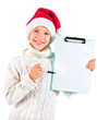 Cute girl with Santa hat showing a blank paper