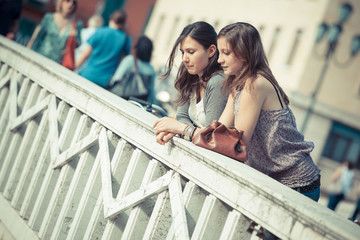 Two Women Talking in the City