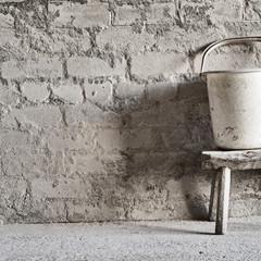 grunge wall, vintage two wheels barrow background