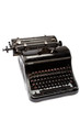 Old antique typewriter on a white background.