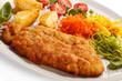 Pork chop, baked potatoes and vegetable salad