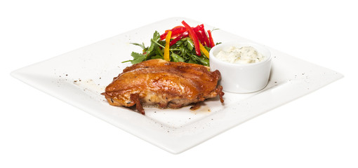 roasted chicken with vegetables on a white plate