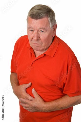 Leinwanddruck Bild Alter Mann mit Magenschmerzen